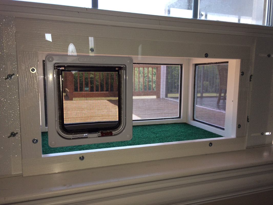 The KPDeluxe 24 Deluxe Kitty Peeper With Plexiglass Front And Cat Door!